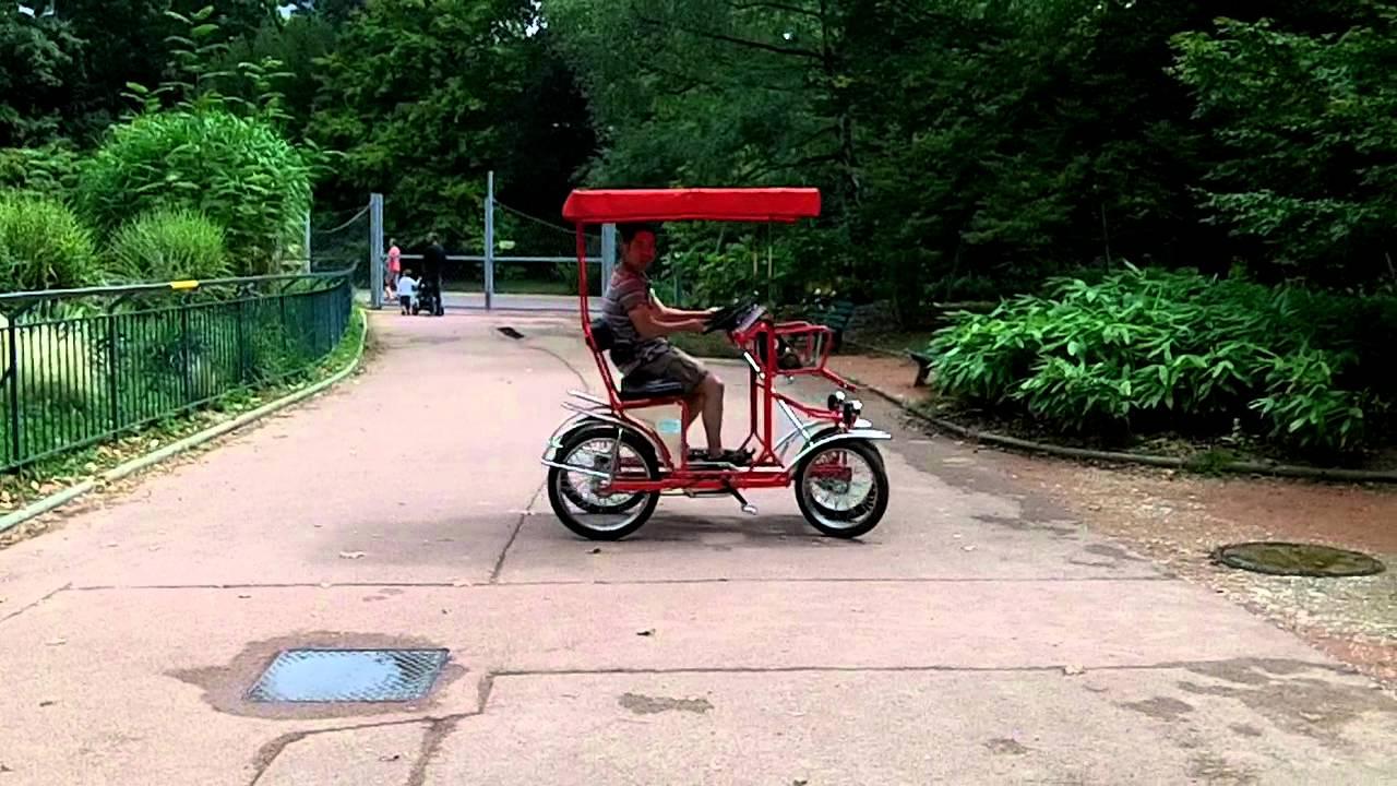 Showing off the 4 person bike in Lyon, parc de la Tête d'Or